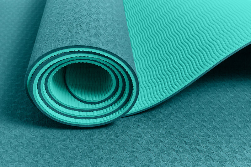 Yogibato Yoga Mat Balance Emerald partially rolled up showing non-slip surface and bottom with close up of structure