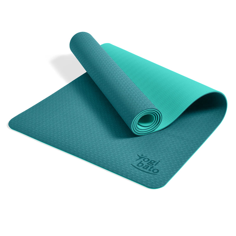 Yogibato Yoga Mat Balance Emerald partially rolled up showing non-slip surface and bottom with carry strap
