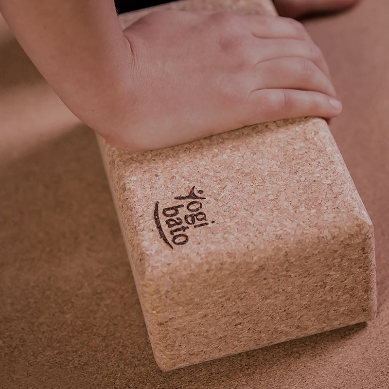 Hand on Yogibato yoga brick cork controlling the stretch during yoga practice