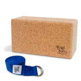 Rolled up Yogi bato Yoga belt in blue with logo with D-ring and yoga block made of cork