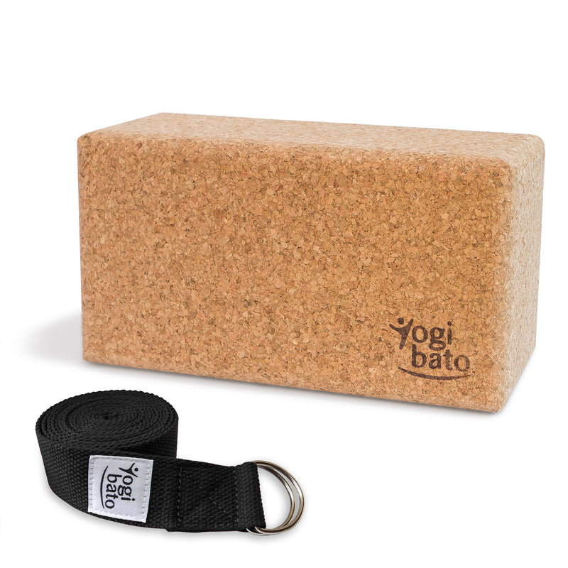 Rolled up Yogi bato Yoga belt in black with logo with D-ring and yoga block made of cork