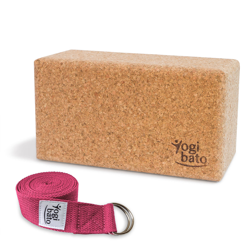 Rolled up Yogi bato Yoga belt in Fuchsia with logo with D-ring and yoga block made of cork