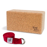 Rolled up Yogi bato Yoga belt in red with logo with D-ring and yoga block made of cork