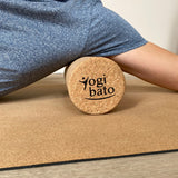 Application of Yogibato yoga roller for massaging and releasing back tension