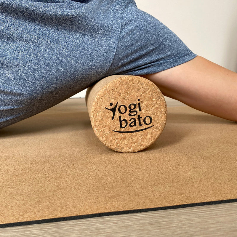 Yogibato Yoga roller cork used to massage and release shoulder and back tension