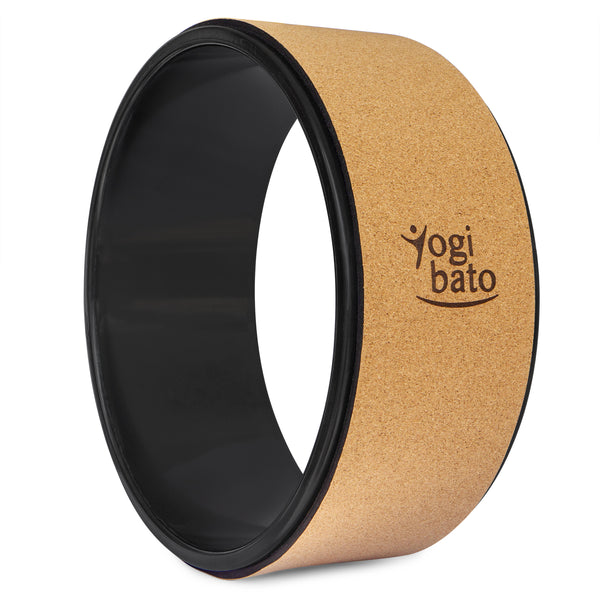 Standing Yogibato Yoga wheel with ABS inner ring, cork outer ring and Yogibato logo