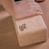 Hand on yogibato yoga brick cork during asana and yoga practice