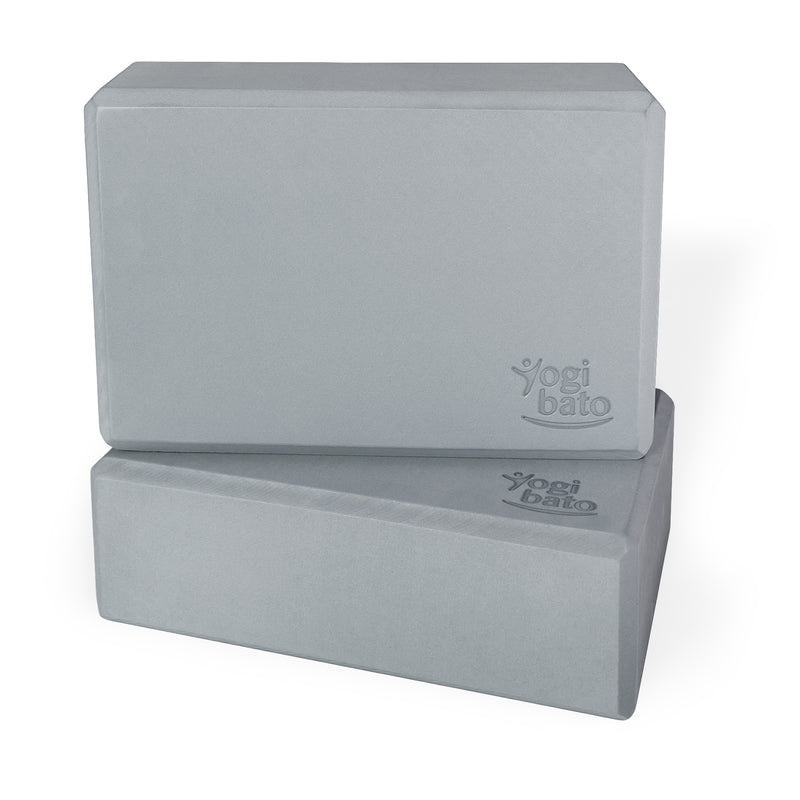 Two grey Yogibato Yoga Blocks made of EVA foam stacked showing non-slip material and flattened edges