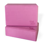 Two fuchsia Yogibato Yoga Blocks made of EVA foam stacked showing non-slip material and flattened edges