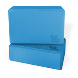 Two blue Yogibato Yoga Blocks made of EVA foam stacked showing non-slip material and flattened edges