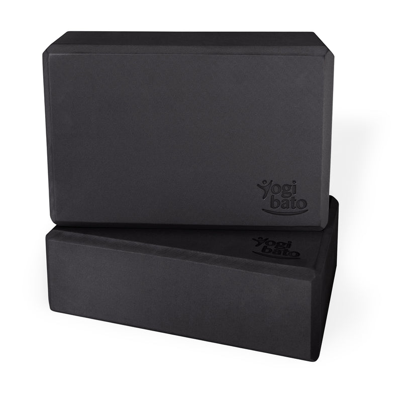 Two black Yogibato Yoga Blocks made of EVA foam stacked showing non-slip material and flattened edges