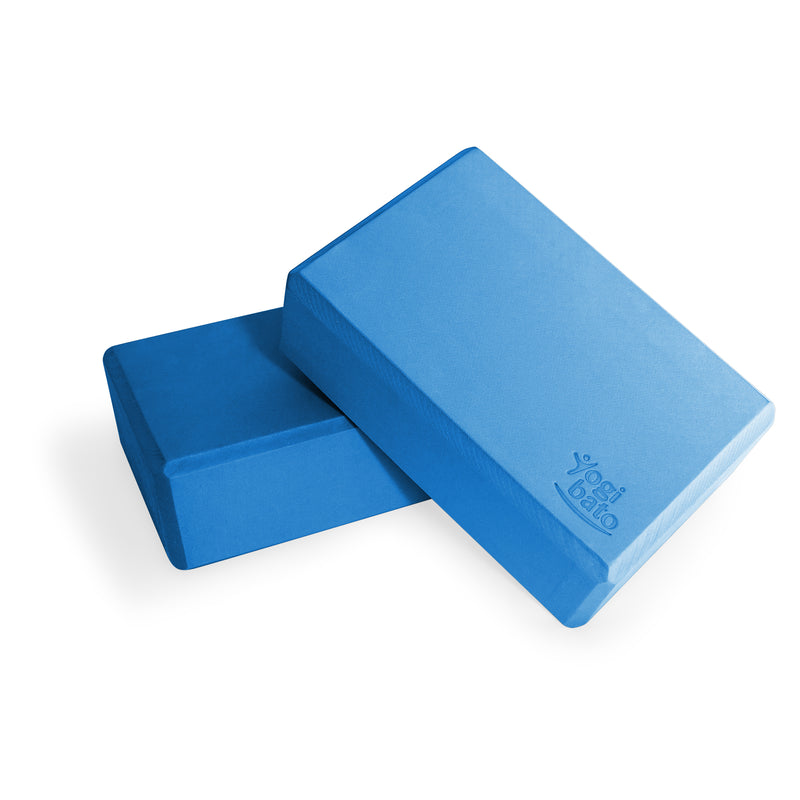 Bundle of two blue Yogibato Yoga Blocks made of EVA foam lying on top of each other showing non-slip material and flattened edges