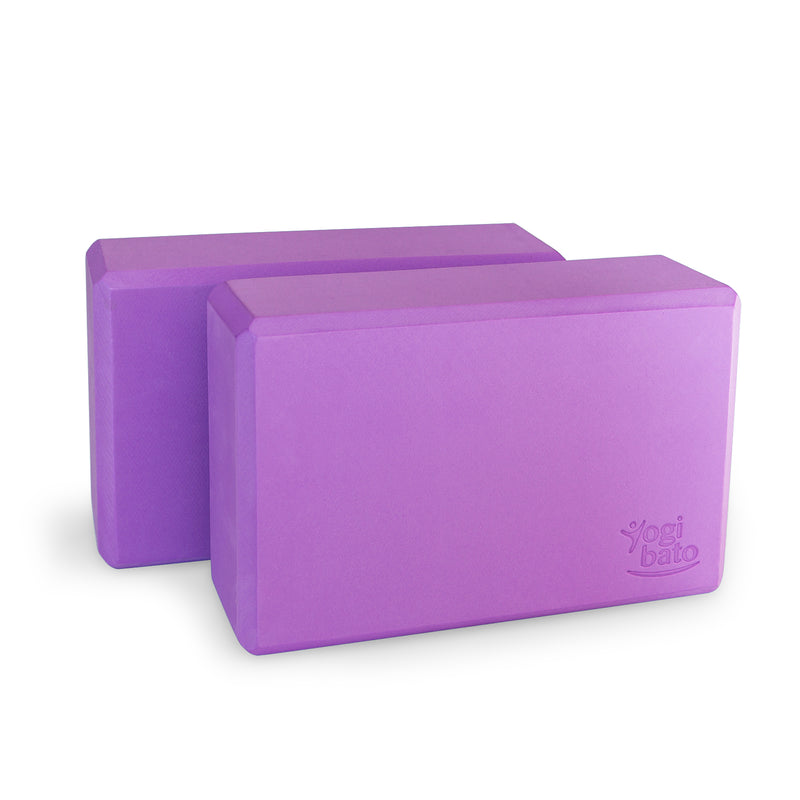 Set of two purple Yogibato Yoga Blocks made of EVA foam standing behind each other showing non-slip material and flattened edges