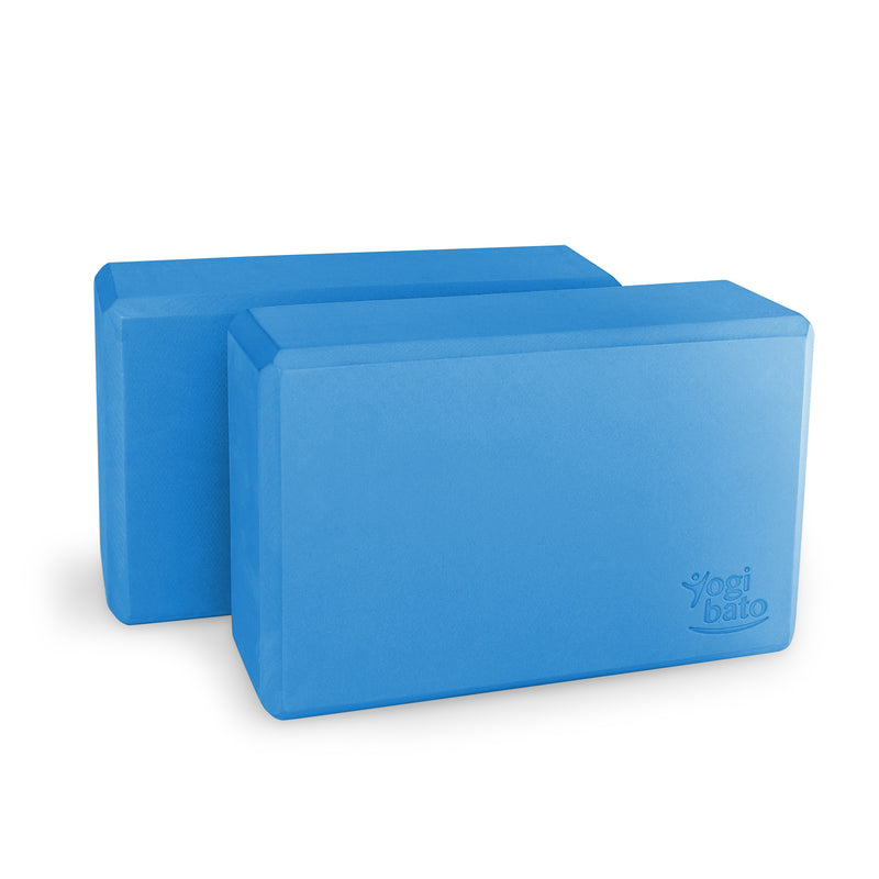 Set of two blue Yogibato Yoga Blocks made of EVA foam standing behind each other showing non-slip material and flattened edges