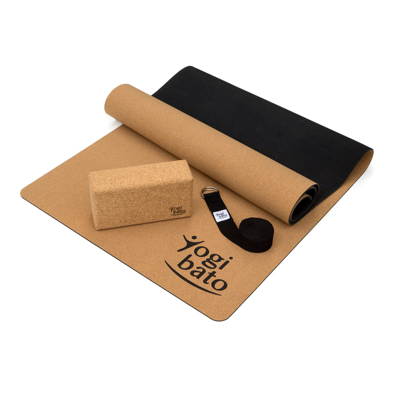 Yoga block made from natural cork and cotton yoga strap in light blue sitting on a Yogibato yoga mat made from natural cork and rubber