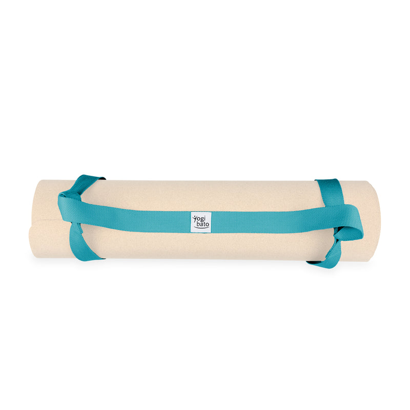 Turquoise Yogibato Yoga mat carrying strap with loops attached to yoga mat