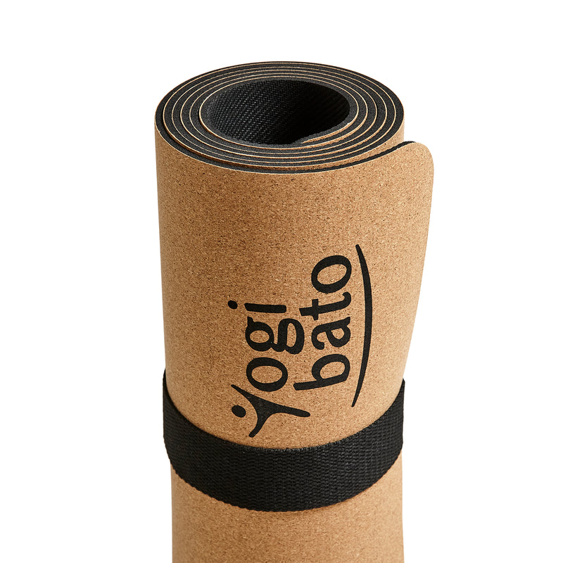 close up of Yogibato yoga mat cork with attached shoulder strap showing cork surface and rubber underside