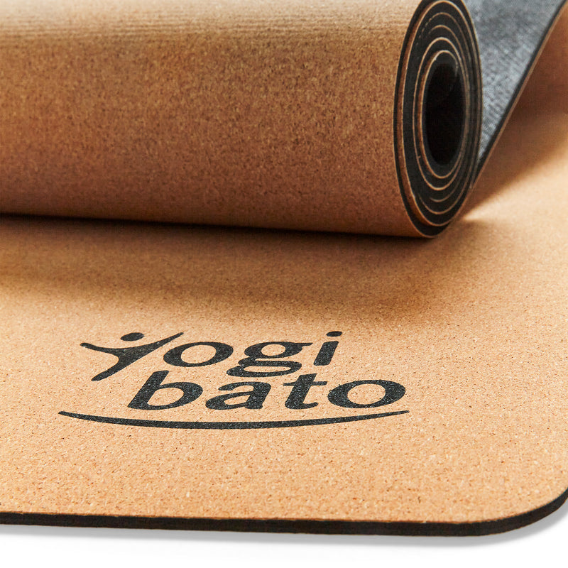 Details of yoga mat cork with Yogibato logo and anti-slip surface and rubber bottom