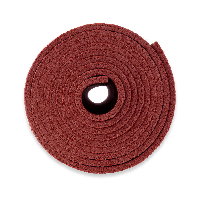 Yogibato Yoga Mat Studio rolled up showing thickness for maxiumum comfort made in Germany and oekotex certificate in color Bordeaux