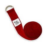 Rolled up Yogibato Yoga belt in Red with logo with 2 D-rings made of metal as buckle