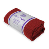 Rolled up Yogibato Yoga towel in bordeaux in white banderole