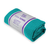 Rolled up Yogibato Yoga towel in turquoise in white banderole