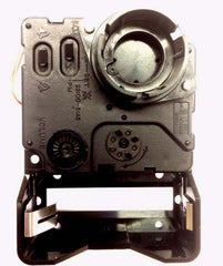 Seiko quartz clock movement with chime. Showing switches on back