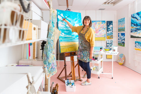 Amy painting in her studio