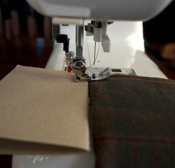 the same photo as the previous one but this time it has a wedge of cardboard at the back of the sewing foot