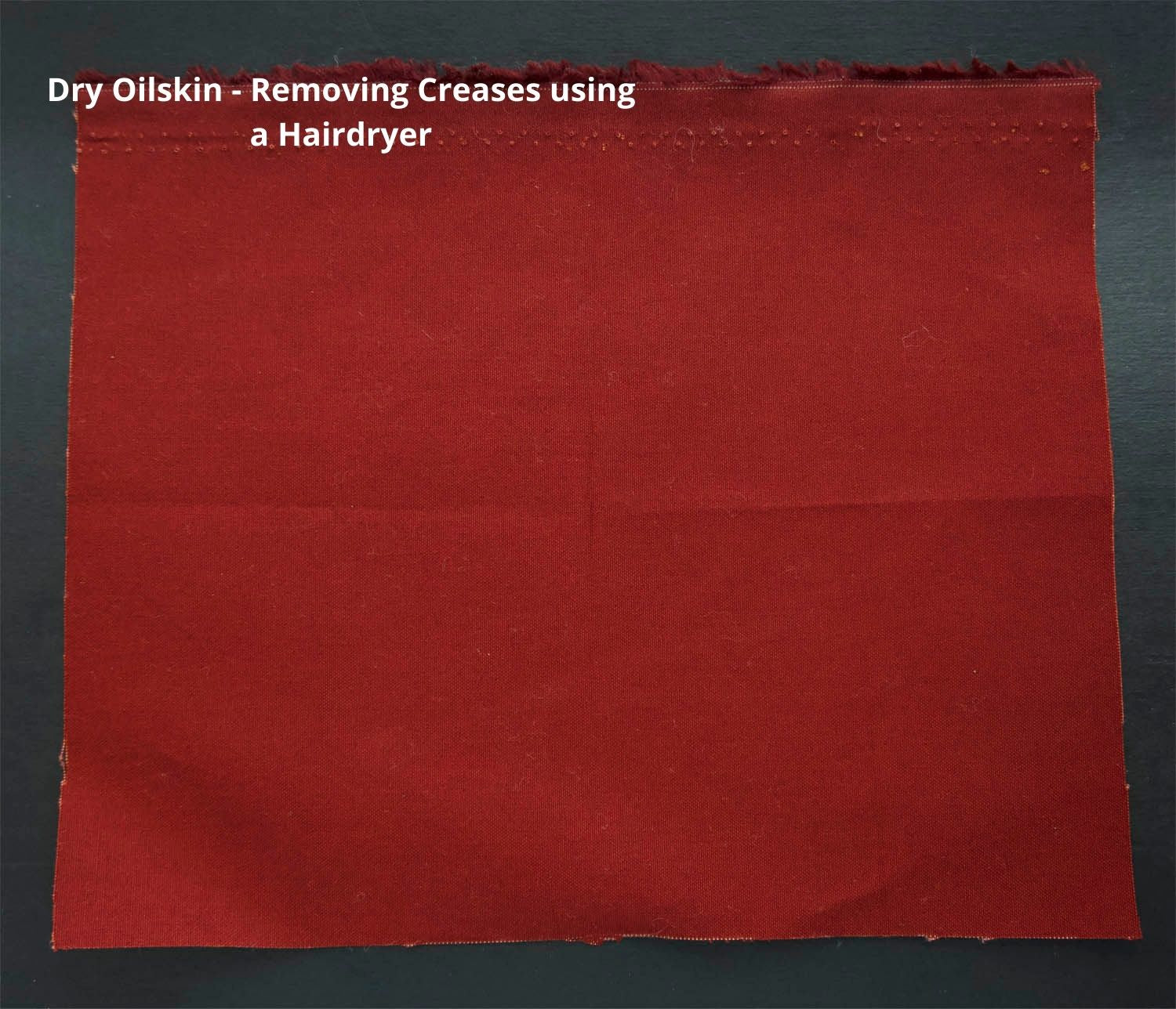 conker coloured traditional oilskin on a dark background