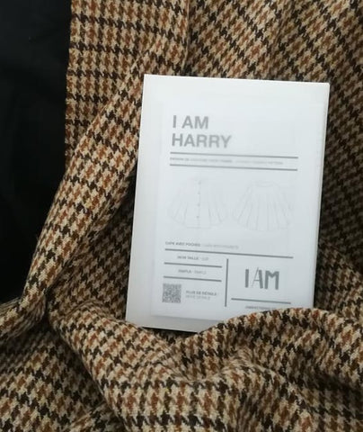 A white I Am Patterns envelope on the the houndstooth tweed