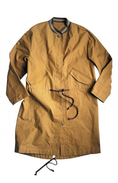 a picture of a jacket on a white back ground. the jacket is a mustard yellow coloured and has a green and gold ribbing neckline