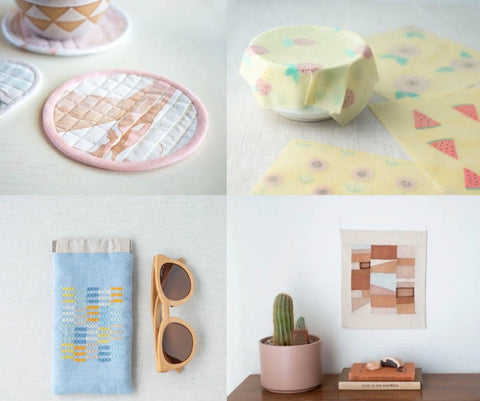 a collection of four images. the top left is a circular coaster on a white table. It has a pink edge and delicate pink abstract pattern on the fabric. It has been quilted in a grid to give texture. the top right is a beeswax wrap in a pale yellow with small water melon patterns on it. The wrap is moulded over a bowl. the bottom left is an abstract picture made up in ochre colours. it has been placed over a desk and on the desk there is a cactus is a pale pink pot and two books stacked next to it. the bottom left image is a glasses case with cross stick embroidery on it. It isn't a picture of anything just crosses in a grid in blocks of yellow, blue and pink and white. a pair of wooden framed sunglasses lie next to it.