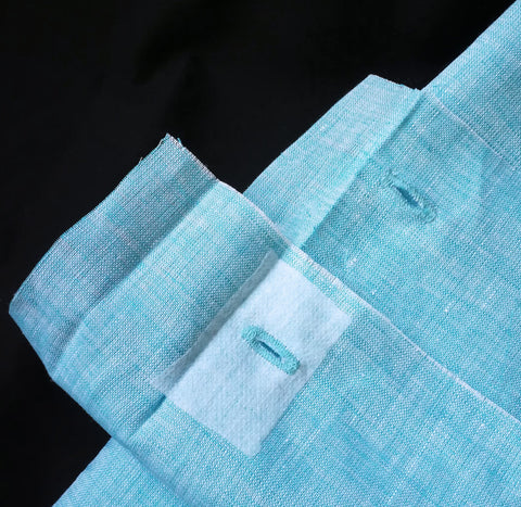 close up image of a buttonhole with interfacing.