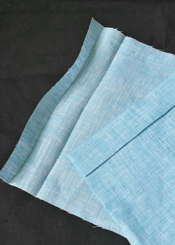 A Close up of turquoise fabric that has been ironed over to mark over the casing