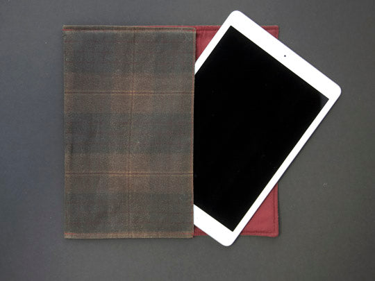 An image of the tablet cover with the iPad coming out of the cover