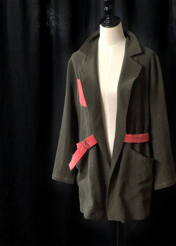 a picture of the Sienna maker jacket open on a dummy showing the belt looping around the back of the jacket