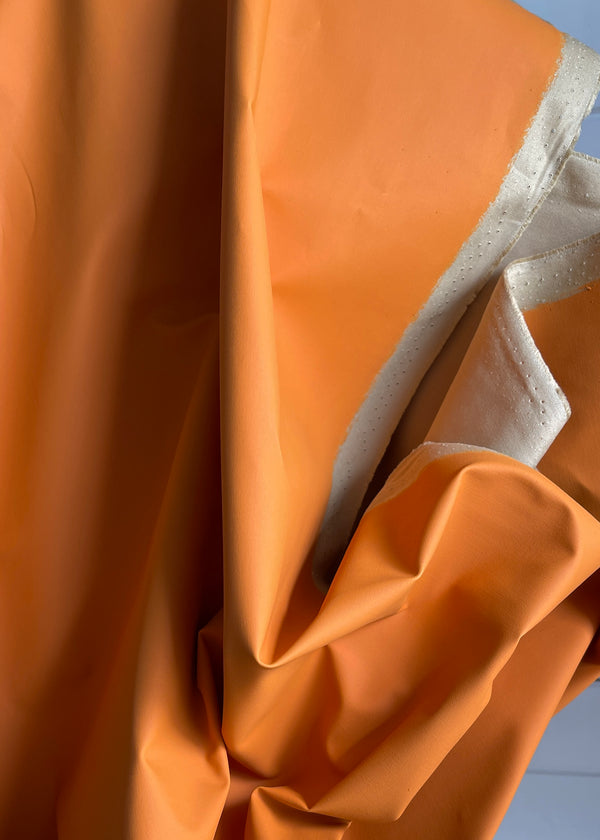 Water Resistant Coated Cotton. Orange