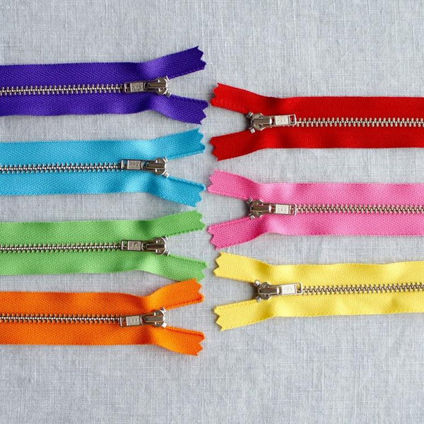 18cm.  YKK Metal, Nickel, Closed End Zip - Ruby Red