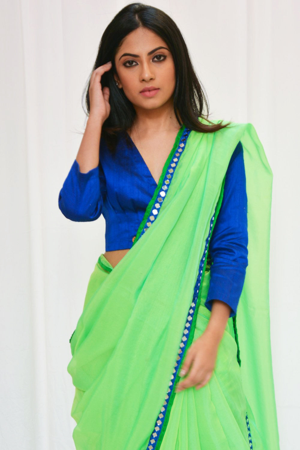 Lime green soft organza saree with blue mirror work embroidered border