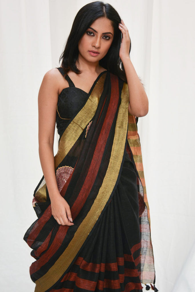 Black and red striped linen saree with peacock appliques