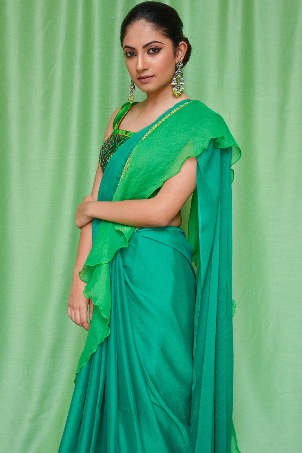 Green shimmer georgette ruffle saree with green-gold border - House of Blouse