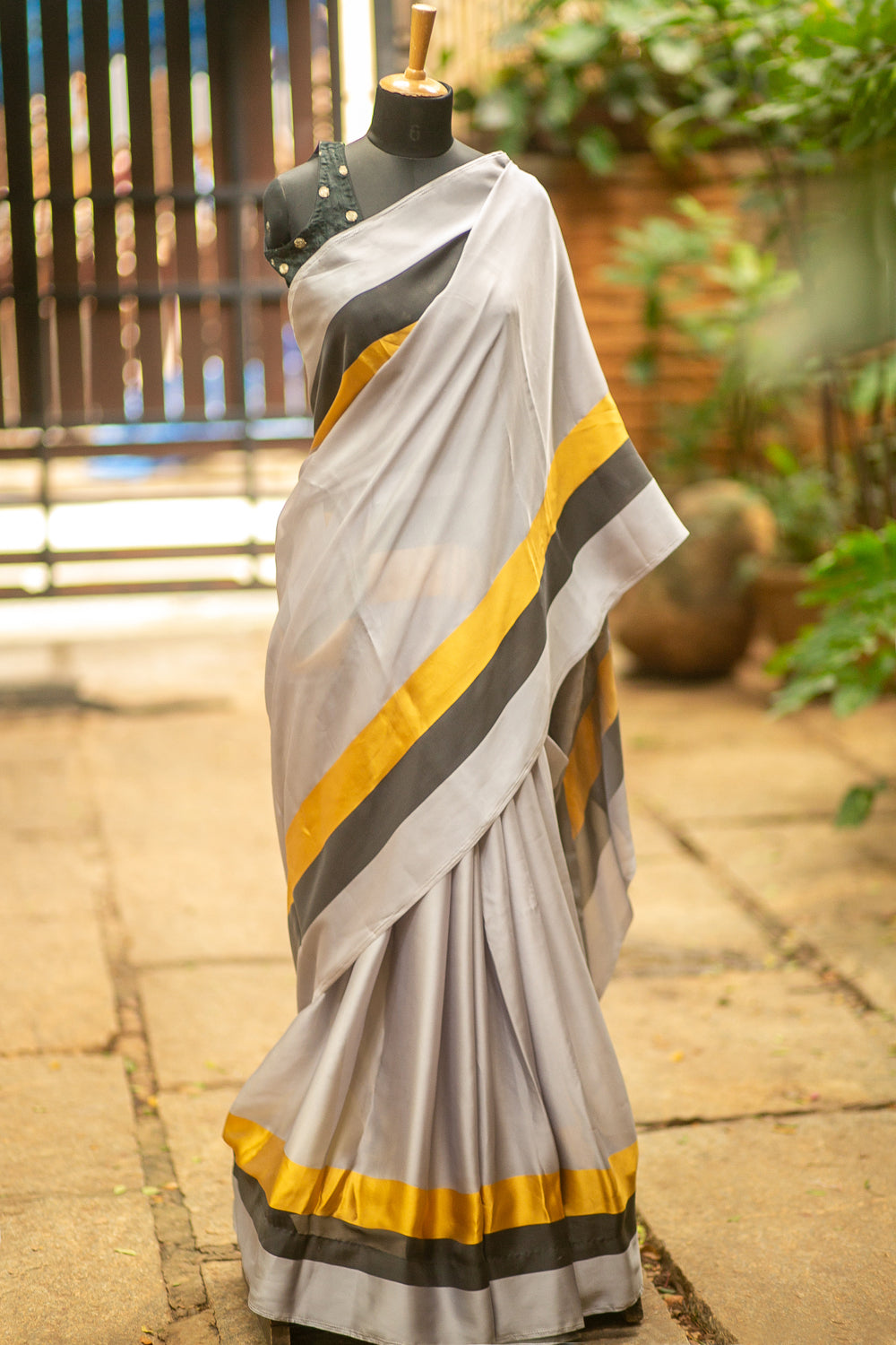 Grey soft satin saree with mustard and black border and cutwork pallu detailing - House of Blouse