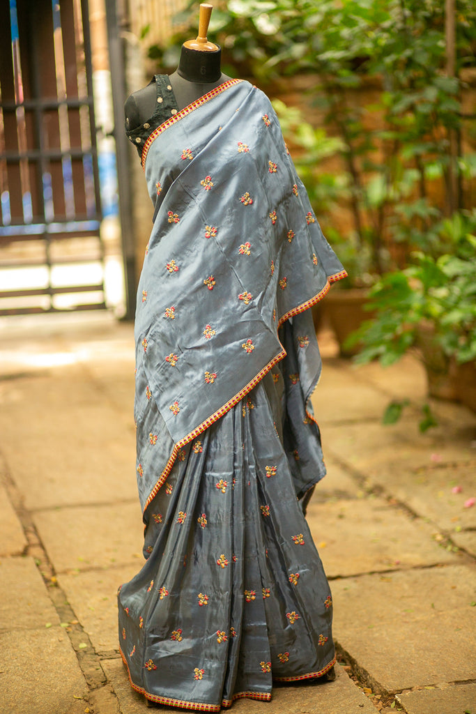 Grey kora silk saree with floral threadwork motifs and multicolour lace edging - House of Blouse