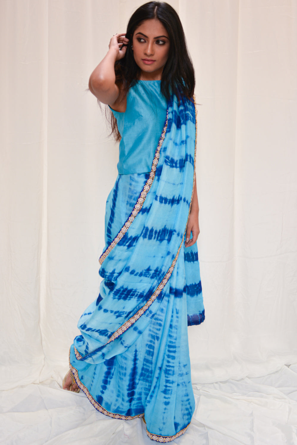 Sky blue shibori shaded jute georgette saree with blue embellished border