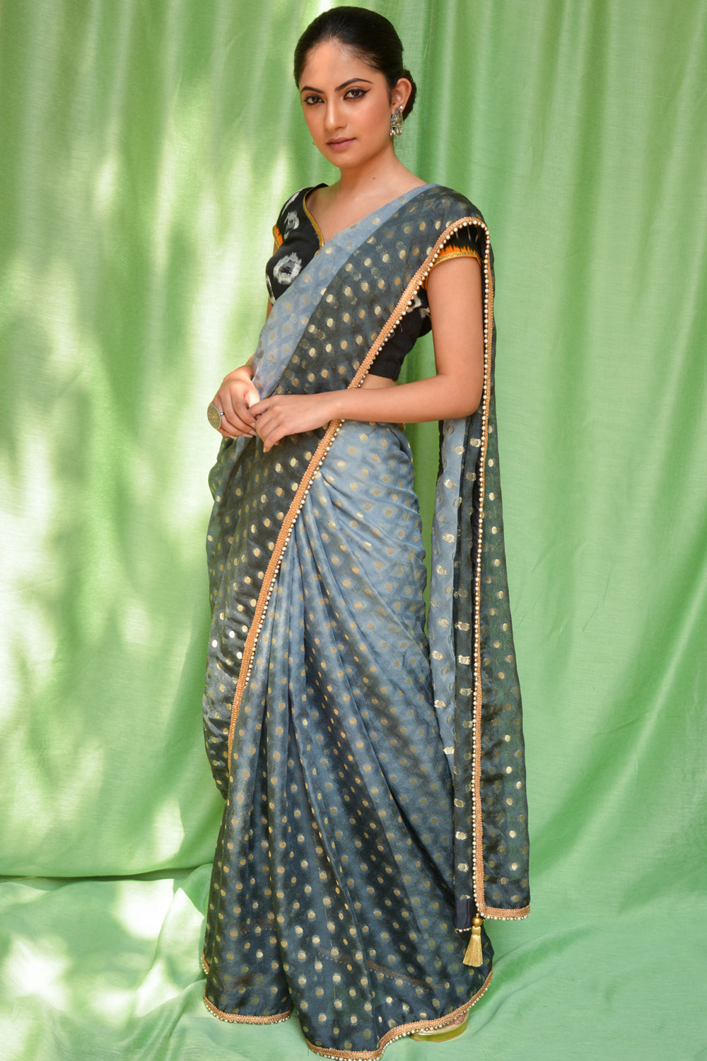 Grey ombre shaded shimmer georgette saree with zari buttis and pearl and gold bead edging