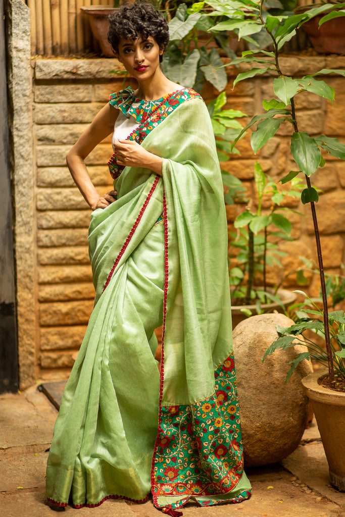 Sage green soft linen saree with handpainted Kalamkari border and maroon floral lace edging - House of Blouse