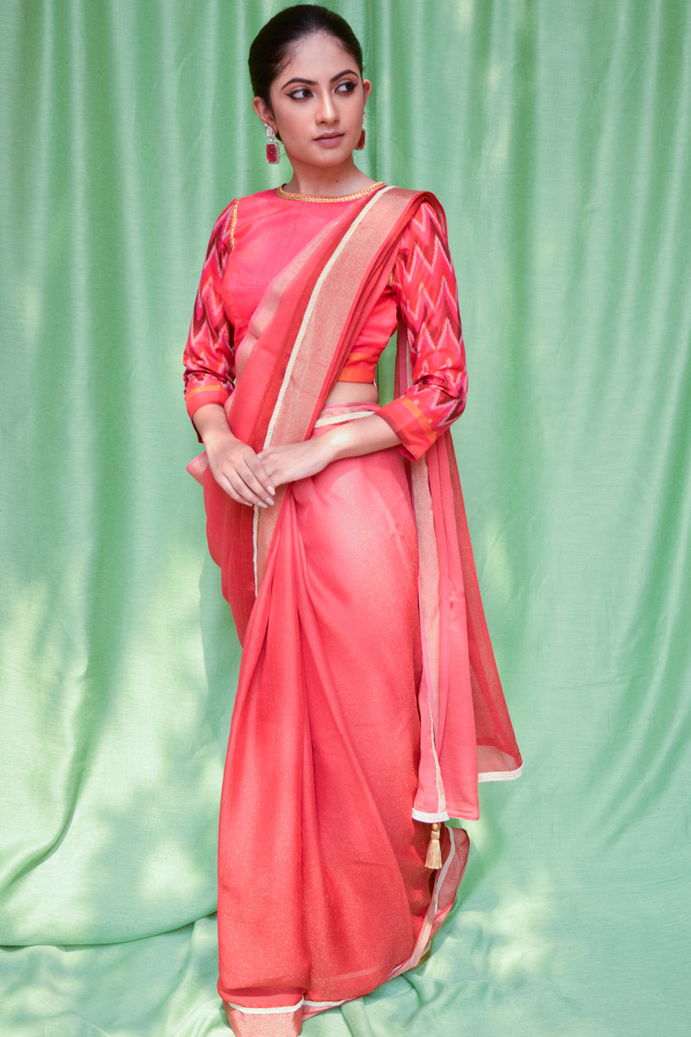 Red ombre shaded shimmer georgette saree with tissue and pearl border
