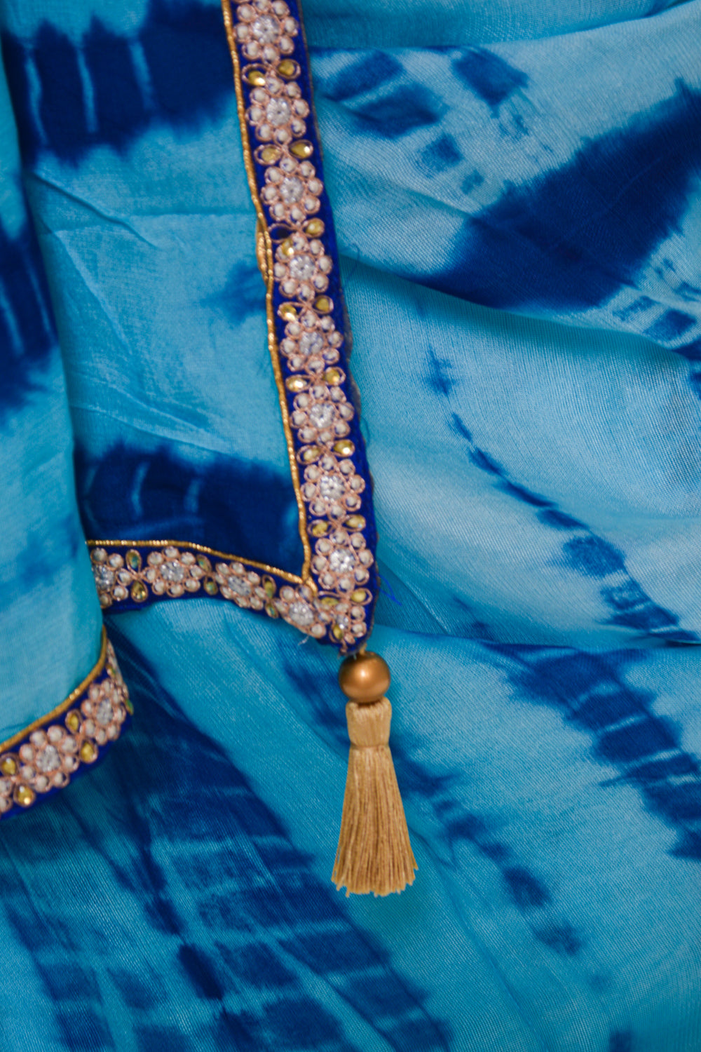 Sky blue shibori shaded jute georgette saree with blue embellished border - House of Blouse
