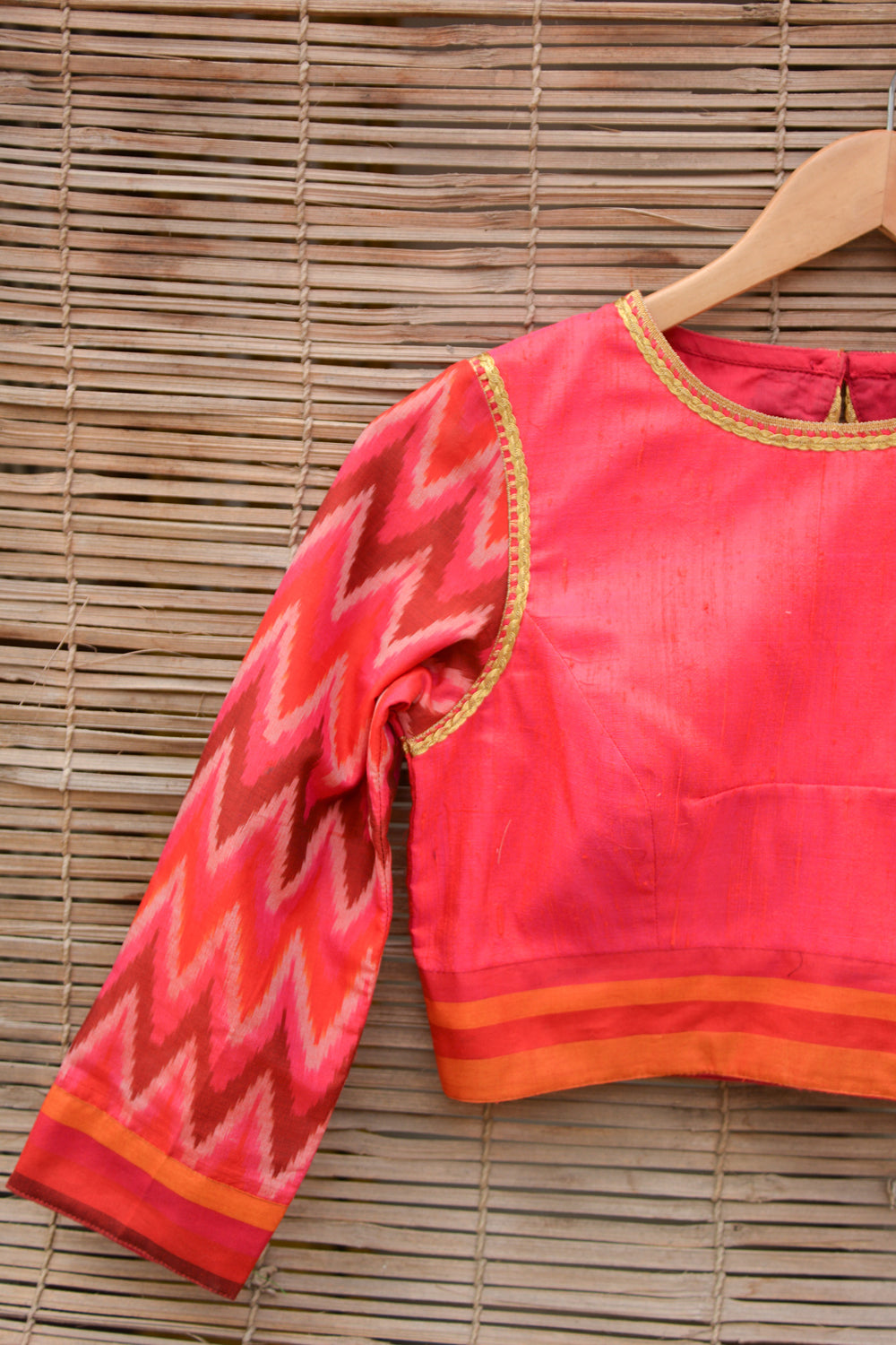 Reddish pink raw silk closed neck blouse with Ikat sleeves